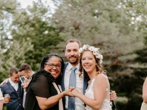 Happy couple with wedding officiant